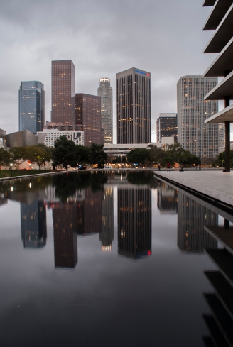 Evening begins to fall over the downtown Los Angeles skyline as viewed from the John Ferraro building's reflecting pool platform.