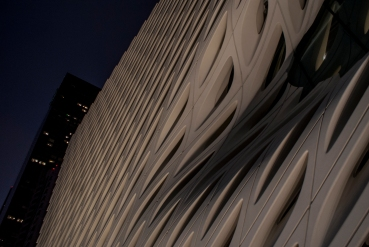 Night lighting strikes the surface of the Broad museum.
