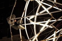 A man enjoys his ride on the ferris wheel at A Night on Broadway.