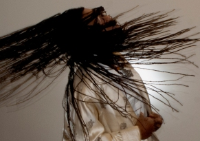 Miki Turner whips her hair for a photo shoot.