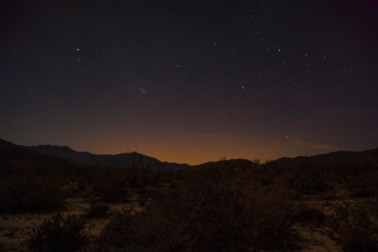 Away from the moonlight, fainter stars glow.