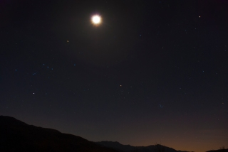 The mountains and moon and desert stars.