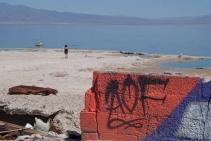 Visitor Lisa Zocco takes in the receding shoreline of the Salton Sea.