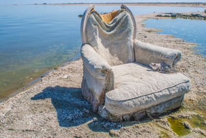 Up close, the elegant fabric of a stranded chair is reminiscent of the booming waterfront community that used to thrive at the Salton Sea.