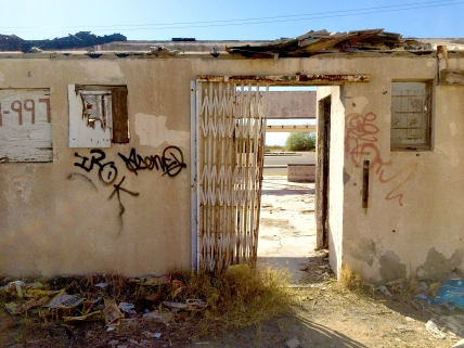 The gates remain open at a destroyed strip mall on the way to Slab City, California.