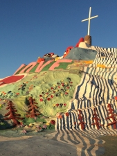 The painted surface of Salvation Mountain bask in the sunset light of the surrounding desert.