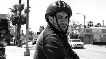 A biker along Vermont Avenue looks suspiciously at a photographer.
