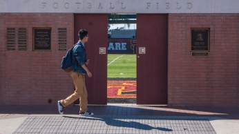 Open doors at Brian Kennedy - Howard Jones Football Field beckons students to glance inside its walls.