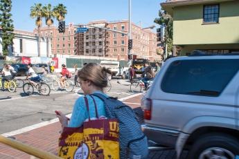 Student bikers meet Los Angeles traffic.